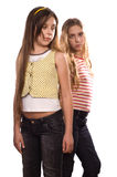 Two teenage girls standing isolated on white Stock Photos