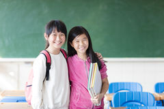 Two teenage girls student in the classroom. Two asian teenage girls student in the classroom Royalty Free Stock Image