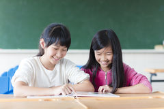 Two teenage girls student study in classroom Stock Photography