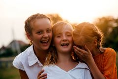Two teenage girls. Three teenage girls have fun in the park, friends portrait Stock Image