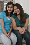 Two teenage girls together at home Stock Photos