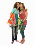 Two teenage girls trying on new clothes, smiling, portrait, cut out Stock Images