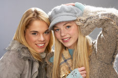Two Teenage Girls Wearing Knitwear In Studio Royalty Free Stock Photo
