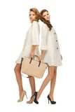 Two teenage girls in white coats with bag Stock Image