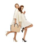 Two teenage girls in white coats with bag Royalty Free Stock Images
