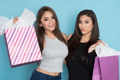 Two Teens Shopping. Two teenage hispanic girls on a shopping trip stock photo