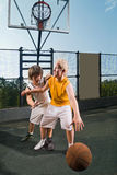 Two teenage players with basketball Royalty Free Stock Photos