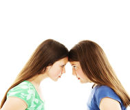 Two teenage sisters staring at each other Royalty Free Stock Image