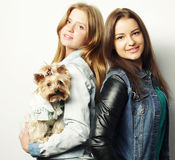 Two teenage sisters with Yorkshire Terrier Royalty Free Stock Photo