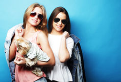 Two teenage sisters with Yorkshire Terrier Royalty Free Stock Image