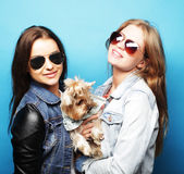 Two teenage sisters with Yorkshire Terrier Stock Photography