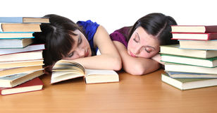 Two teenage student owned by books Royalty Free Stock Image