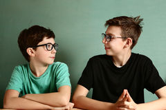 Two teenager boys in myopia glasses close up Stock Images