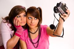 Two teenager and a camera Stock Images