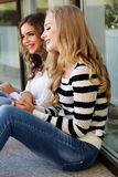Two teenager girls with books Royalty Free Stock Photo