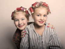 Two teenager girls playing Housewives, do yourself hairstyles and makeup having fun.  Royalty Free Stock Photo