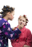 Two teenager girls playing Housewives, do yourself hairstyles and makeup having fun Stock Image