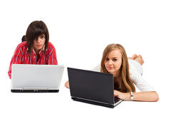 Two teenager girls surfing the net Stock Photo
