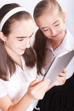 Two Girl with ipad like gadget Royalty Free Stock Photo