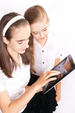 Two Girl with ipad like gadget Stock Photos