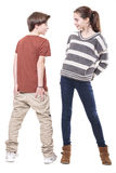 Two teenager, male and female smiling at each other. Isolated on white Royalty Free Stock Images