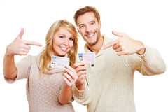 Two teenager showing drivers. Two happy teenager showing proudly their German drivers licence royalty free stock images
