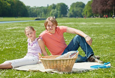 Two teenager siblings at picnic Stock Images