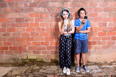 Two Teenager with Smartphones Stock Photography