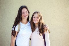Two teenage girls. Two teenager smiling sisters girls Royalty Free Stock Image