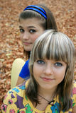 Two teenagers. And autumn leaves Royalty Free Stock Photo