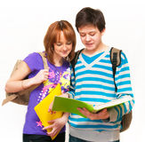 Two teenagers. Two young students a over white background Royalty Free Stock Photos