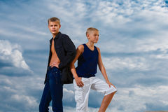 Two teenagers on the beach. Looks thoughtfully into the distance Stock Photography