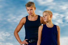 Two teenagers on the beach. Looks thoughtfully into the distance Stock Images