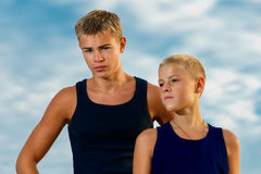 Two teenagers on the beach. Looks thoughtfully into the distance. The sky in the background. Summer vacation concept Stock Photo