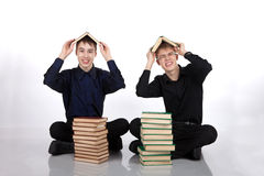Two teenagers with books on her head Royalty Free Stock Photo