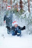 Two teenagers in Christmas hats Santa Claus having fun in the sn Royalty Free Stock Photo