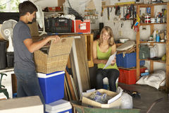 Two Teenagers Clearing Garage For Yard Sale Stock Photography