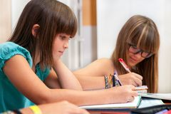 Two teenagers doing homework.