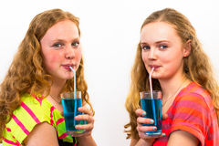 Two teenagers drink blue soda Royalty Free Stock Images