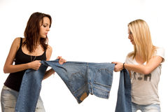 Two teenagers fighting over jeans royalty free stock photography