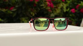 Two teenagers girl playing, swimming and enjoy the sun`s rays in the backyard pool. reflection in sunglasses.  stock video footage