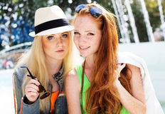 Two teenagers girl walking in city center Stock Photos