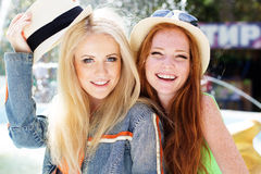 Two teenagers girl walking in city center Royalty Free Stock Photo