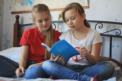Two teenagers girls at home makes homework. Close up Royalty Free Stock Photos