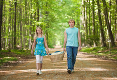 Two teenagers going to picnic Stock Photos