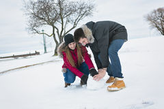 Two teenagers havinf fun on the snow field Stock Photo