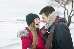 Two teenagers havinf fun on the snow field Royalty Free Stock Image