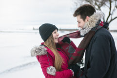 Two teenagers havinf fun on the snow field Stock Images
