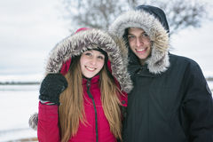 Two teenagers havinf fun on the snow field stock image