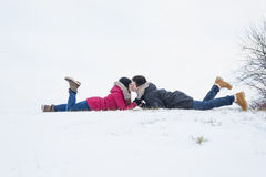 Two teenagers havinf fun on the snow field stock photography